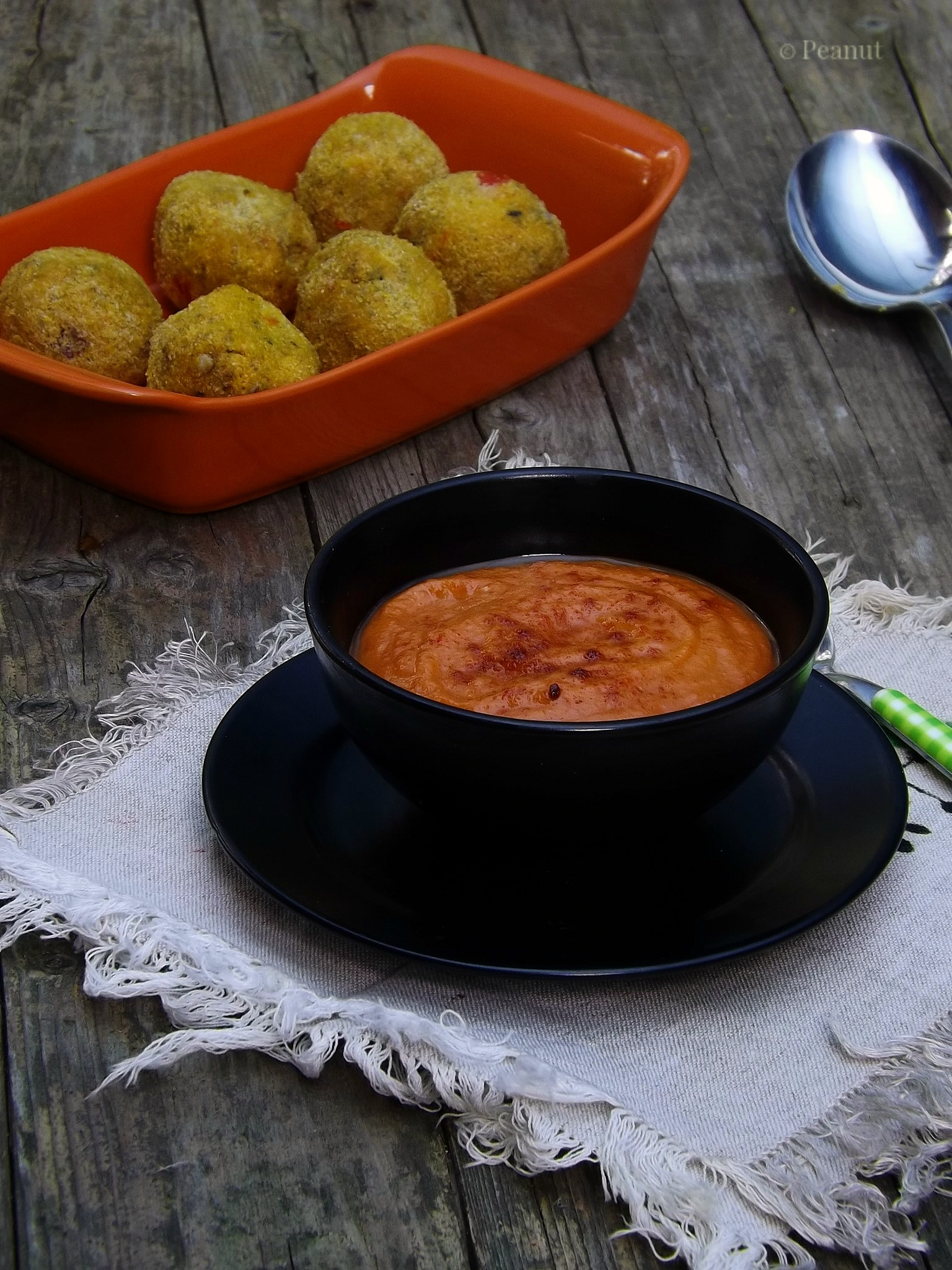 Raw carrot almond pulp balls with ketchup